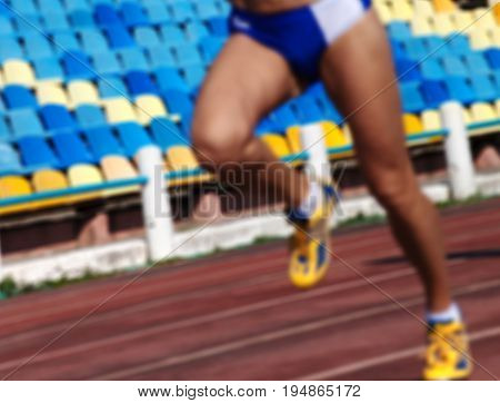 Blurred Athletic Running Competition At Stadium Not In Focus