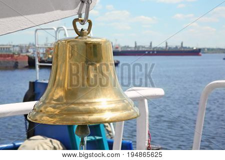 Big ship bell onboard the vessel in sea port