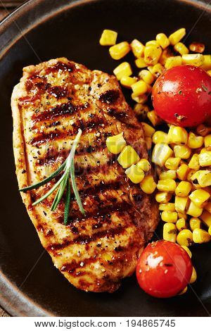 Grilled turkey fillet with sweetcorn and tomatoes