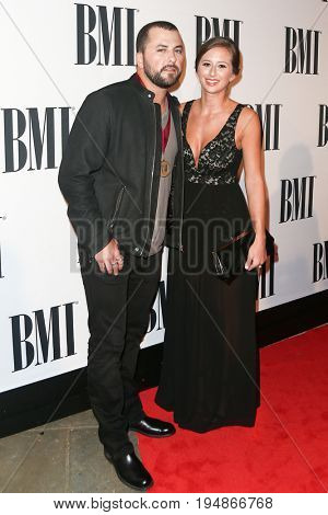 NASHVILLE, TN-NOV 3: Recording artist Tyler Farr (L) and Hannah Freeman attend the 63rd annual BMI Country awards at BMI on November 3, 2015 in Nashville, Tennessee.