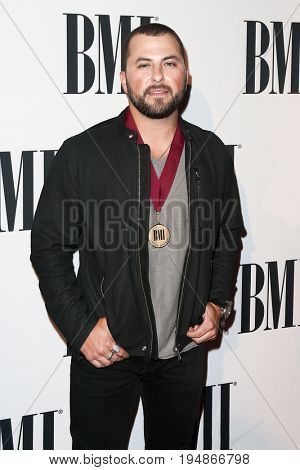 NASHVILLE, TN-NOV 3: Recording artist Levi Hummon and guest attend the 63rd annual BMI Country awards at BMI on November 3, 2015 in Nashville, Tennessee.
