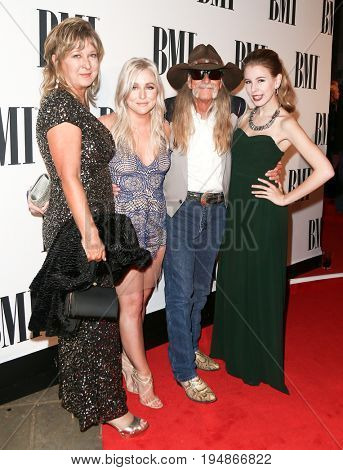 NASHVILLE, TN-NOV 3: Susie Dillon (L) and Dean Dillon (2nd R) attend the 63rd annual BMI Country awards at BMI on November 3, 2015 in Nashville, Tennessee.