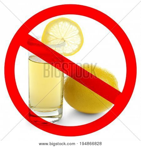 Alcohol drink in glass with STOP sign on white background