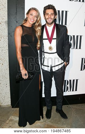 NASHVILLE, TN-NOV 3: Recording artist Thomas Rhett (R) and wife Lauren Rhett attend the 63rd annual BMI Country awards at BMI on November 3, 2015 in Nashville, Tennessee.