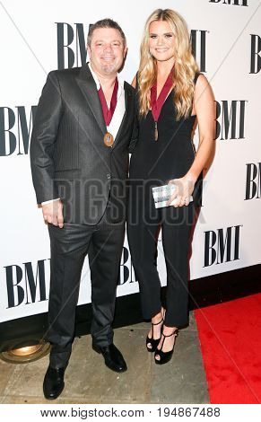 NASHVILLE, TN-NOV 3: Songwriter Rodney Clawson (L) and Nicolle Galyon attend the 63rd annual BMI Country awards at BMI on November 3, 2015 in Nashville, Tennessee.