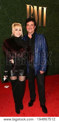 NASHVILLE, TN-NOV 3: Big Machine Label Group President Scott Borchetta (R) and wife Sandi Spika Borchetta attend the 63rd annual BMI Country awards at BMI on November 3, 2015 in Nashville, Tennessee.