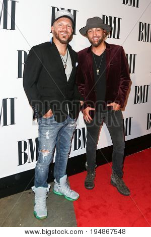 NASHVILLE, TN-NOV 3: Recording artists Chris Lucas (L) and Preston Brust of Locash attend the 63rd annual BMI Country awards at BMI on November 3, 2015 in Nashville, Tennessee.