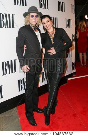 NASHVILLE, TN-NOV 3: Recording artist Big Kenny (L) and wife Christiev Carothers attend the 63rd annual BMI Country awards at BMI on November 3, 2015 in Nashville, Tennessee.
