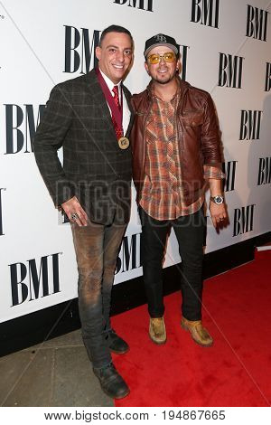 NASHVILLE, TN-NOV 3: Recording artist Stephen Barker Liles (R) and guest attend the 63rd annual BMI Country awards at BMI on November 3, 2015 in Nashville, Tennessee.