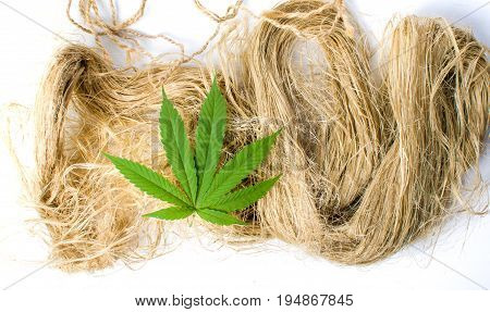 Marijuana Leafs On Top Of Hemp Fibers