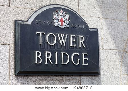 Tower Bridge on the River Thames plaque with name of bridge London United Kingdom. The bridge is a symbol of the city and a great attraction for tourists