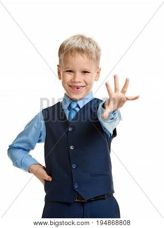 Cheerful smiling young schoolboy showing five fingers