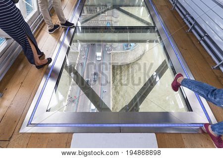 LONDON UNITED KINGDOM - JUNE 22 2017: Tower Bridge on the River Thames.Glass floor ceiling mirror tourists. The bridge is a symbol of the city and a great attraction for tourists
