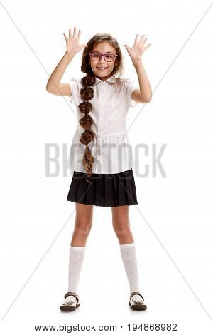 Full portrait of happy girl in school uniform showing five fingers