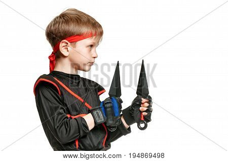 Portrait of young sporty boy holding ninja weapon. Cosplay hero ninja poster