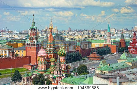 View on Moscow Red Square, Kremlin towers, Clock Kuranti, Saint Basil's Cathedral church, Lenin mausoleum. Panorama Hotel Russia. Moscow holidays vacation tours famous sightseeing. Moscow Red Square poster