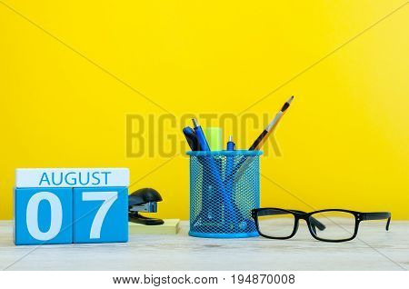 August 7th. Image of august 7, calendar on yellow background with office supplies. Summer time.
