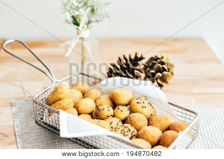 Freshy fried spanish croquetas or crockets filled with chicken jamon or cod fish typical and traditional delicious savoury tasty tapas