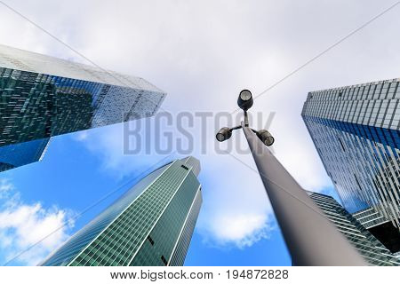 Photo of Streetlight or street lamp with blurred skyscrapers in background. Business center of the Moscow city concept.