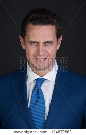 Happy Man Smiling In Fashionable Blue Suit Jacket And Tie