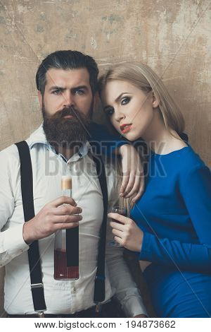 Woman And Man Posing With Bottle And Glass Of Liqueur