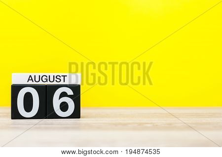 August 6th. Image of august 6, calendar on yellow background with empty space for text. Summer time.
