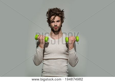 Man With Barbell Doing Morning Exercise, Has Uncombed Hair