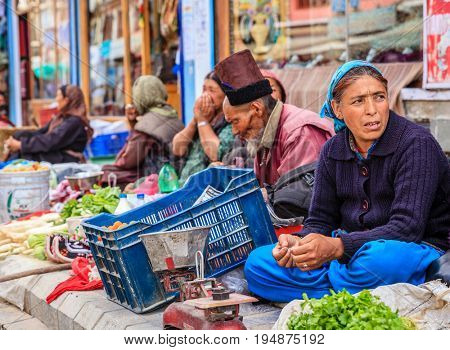 Leh, Ladakh, India, July 12, 2016: produce vendors on a sidewalk market in Leh, Ladakh district of Kashmir, India