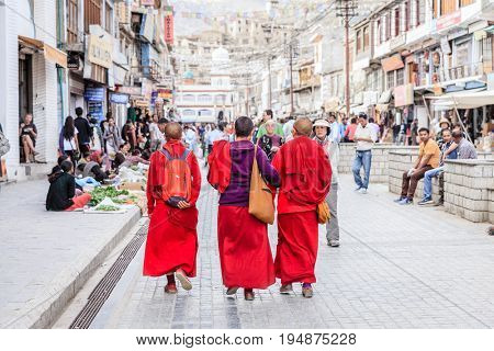 Leh, Ladakh, India, July 12, 2016: three Buddhist monks walking on the main shopping street in Leh, Ladakh district of Kashmir, India
