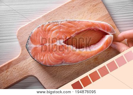 Salmon color lineal and fish steak on wooden board