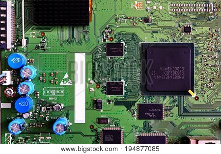 Electronic Circuit Board Green Color Close-up. High-tech Computer Motherboard For Tv.