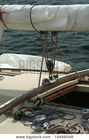 Detail of a sailing yacht. Sail, fastening and cords. Aboard a sailing yacht.