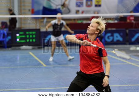 ST. PETERSBURG, RUSSIA - JULY 7, 2017: Elena Komendrovskaja of Russia (in front) vs Delphine Lansac of France in 3rd day of badminton tournament White Nights. Lansac won 2-0