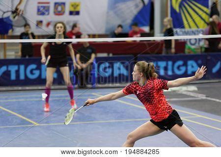 ST. PETERSBURG, RUSSIA - JULY 7, 2017: Anastasiya Cherniavskaya of Belarus (in front) vs Olga Arkhangelskaya of Russia in 3rd day of badminton tournament White Nights. Arkhangelskaya won 2-0
