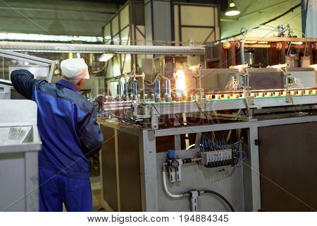 ST. PETERSBURG, RUSSIA - JUNE 29, 2017: Worker in the drinking water factory of Lider-Aqua  LTD. The factory is certified by regional quality certification program