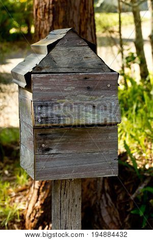 Rustic Old Grey Wooden Mailbox on post