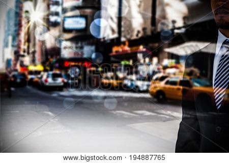 Mid section of well dressed businessman against blurry new york street