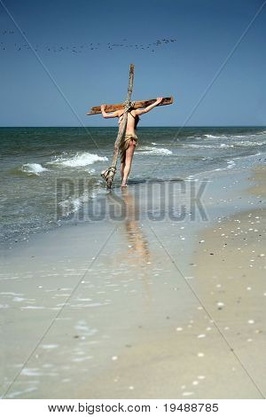 male plays the part of Christ on the cross... It is a perfect image for your design