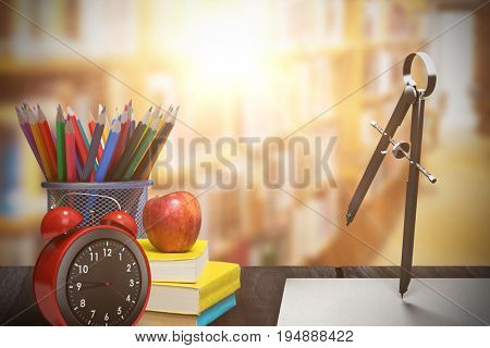 Composite of drawing compass against aisle along bookshelves in college library