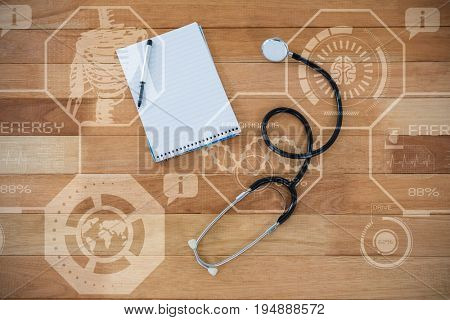 Digitally composite image of human fitness illustration against stethoscope with pen and notepad