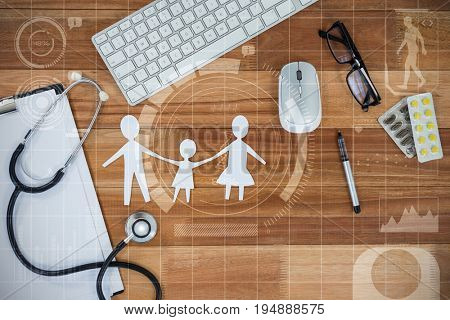 Human development illustration over black background against paper cut out family chain with various medical equipment and keyboard