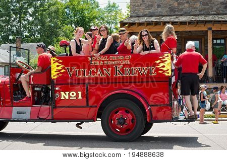 MENDOTA, MN/USA - JULY 8, 2017: Vulcan Krewe of Saint Paul Winter Carnival lore waves to crowd from motorcade proceeding along the historic city's main street during annual Mendota Day Parade.