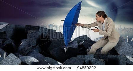 Full length of businesswoman defending with blue umbrella  against full frame shot of sky