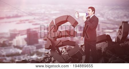 Standing businessman shouting through a megaphone against view of crowded cityscape Aerial view of crowded cityscape