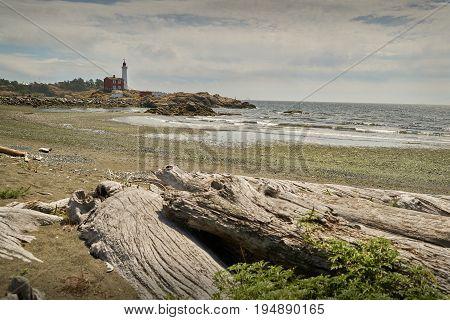 Fisgard Lighthouse Shoreline. Historic Fisgard Lighthouse located near Victoria, British Columbia overlooking the Strait of Juan de Fuca.