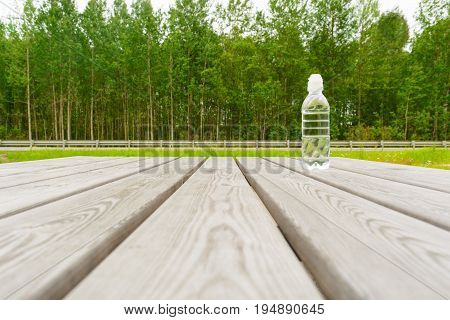 Rest pause in forest near the road with nature view in summer. After sport concept