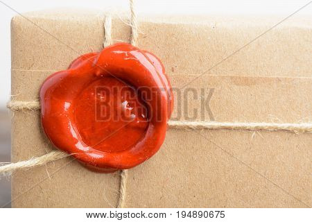 Wrapped Package In Craft Paper With Rope And Sealing Wax