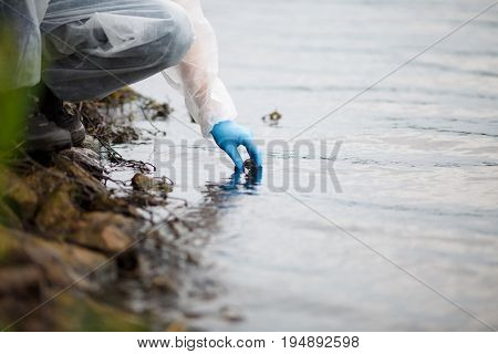 Human takes sample of water