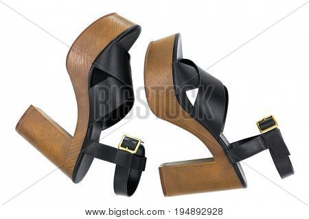 Side view of Black high-heel shoes with open toe cross strap platform sandals with brown chunky block heel, ankle strap fastens with metal buckle isolated on white
