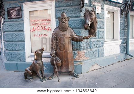 Yekaterinburg, Russia - June 2, 2017: The Friends Composition (sculpture Consists Of Figures Of Dog,